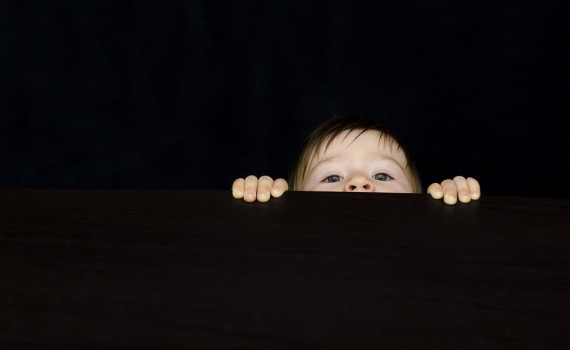 Curiosity Peeking Over Table